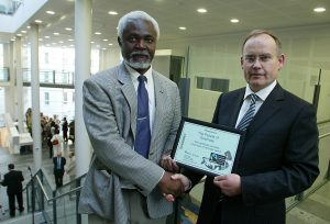 Picture By Peter Frankland. 08-06-06 Simeon Greene MBE is over to accept Guernsey as a Fairtrade Island. L-R - Simeon Greene presents Richard Collas with a certificate. REF: 29FE7199.JPG