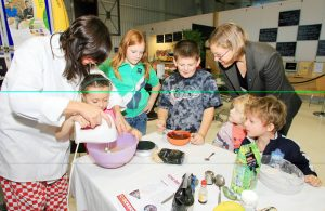 Pic by Daniel Guerin 26-10-06  Children learning to bake cookies with Fairtrade ingredients Pic by Daniel Guerin 26-10-06  Children learning to bake cookies with Fairtrade ingredients. l-r:- Claire Lyons, Deon Walden (6), Scarlett Bruce-Ide (10), Thomas Scott (9), Fairtrade Guernsey Steering Group member Nicky Terry, Charlotte Cleal (3) and James Cleal (5) REF: OP2Y2553.JPG